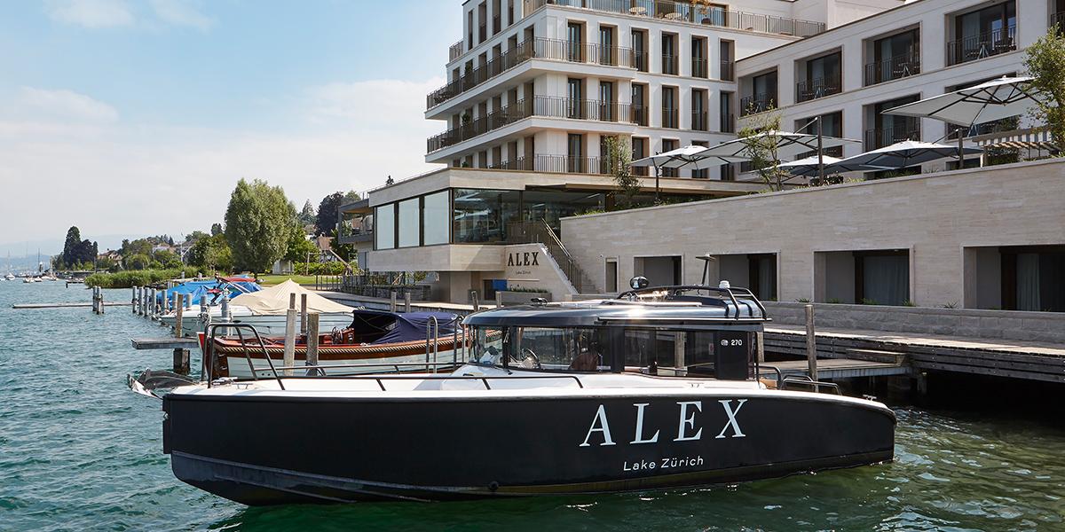 Alex_lake_z_rich_motorboat_parked_hotel_background